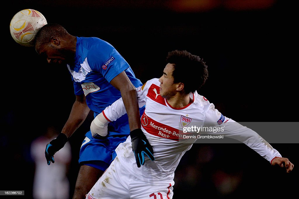 Khaleem Hyland of Genk heads the ball under the pressure of <a gi-track='captionPersonalityLinkClicked' href=/galleries/search?phrase=Shinji+Okazaki&family=editorial&specificpeople=4320771 ng-click='$event.stopPropagation()'>Shinji Okazaki</a> of Stuttgart during the UEFA Europa League Round of 32 second leg match between KRC Genk and VfB Suttgart at Cristal Arena on February 21, 2013 in Genk, Belgium.