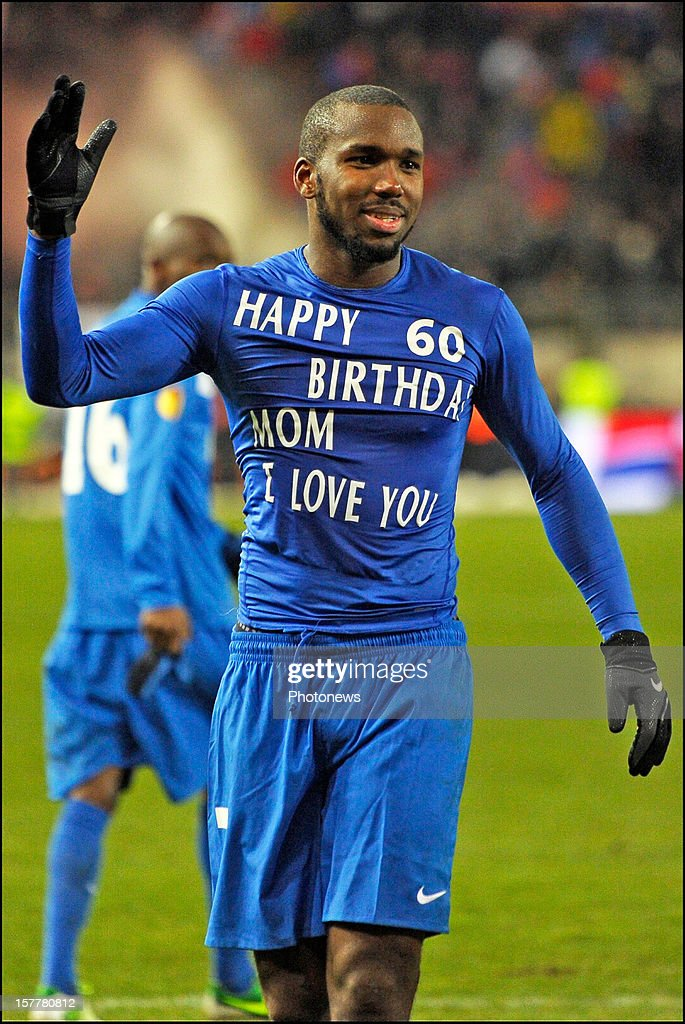 Khaleem Hyland of KRC Genk wears a T-shirt that says 'Happy 60th birthday mom, I love you' after the UEFA Europa League group G - matchday 6 match between KRC Genk and FC Basel 1893 at the Cristal Arena stadium on December 06, 2012 in Genk, Belgium.