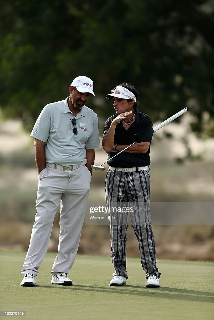 Khalfan Al Kaabi reacts with Rock Star, Alice Cooper during the pro-am of the Omega Dubai Desert Classic at Emirates Golf Club on January 30, 2013 in Dubai, United Arab Emirates.