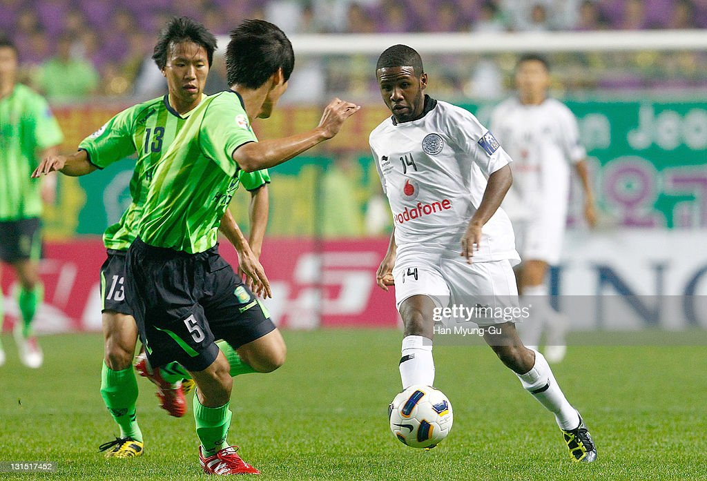 Khalfan Ibrahim of Al Sadd and Son Seng-Jun of Jeonbuk Hyundai Motors compete for the ball during the AFC Champions League Final Match between Jeonbuk Hyundai Mortors of South Korea and Al Sadd of Qatar at Jeonju World Cup Stadium on November 05, 2011 in Jeonju, South Korea. Al Sadd won the Match against Jeonbuk Hyundai Motors.