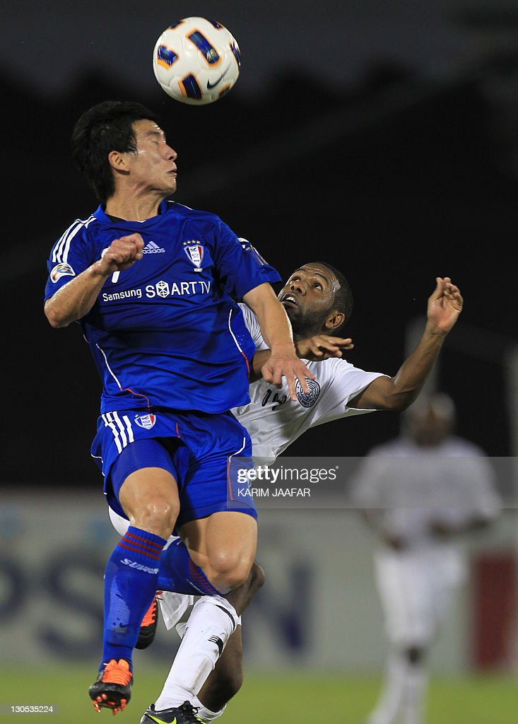 Khalfan Ibrahim of Qatar's Al-Sadd club (R) challenges Oh Jang Eun (L) of South Korea's Suwon Samsung Bluewings during their AFC Champions League semi-final football match at Al-Sadd stadium in Doha, on October 26, 2011. Suwon won 1-0.