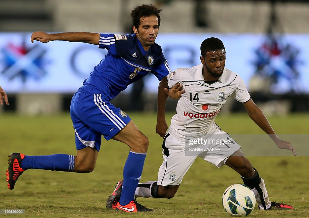 Khalfan Ibrahim (R) of Qatar's Al-Sadd fights for the ball against Mustafa Jalal (L) of Al-Khor during their Qatar Stars League football match in Doha, on November 23, 2012. Al-Sadd won 2-1. AFP PHOTO/KARIM JAAFAR/ AL-WATAN DOHA== QATAR OUT ==