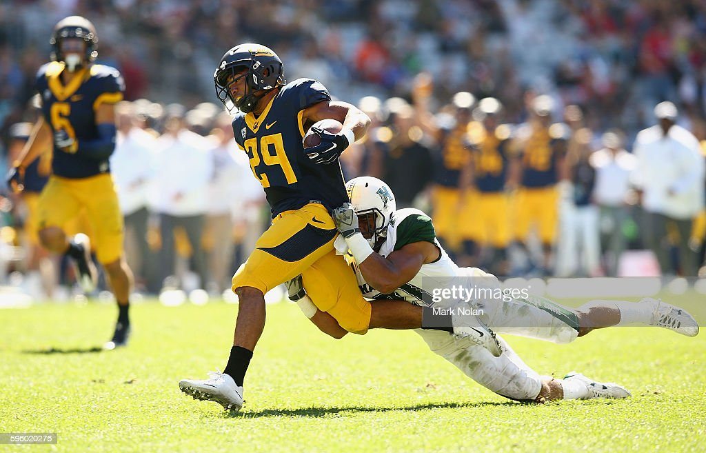 Khalfani Muhammad of the California Golden Bears is tackled during the College Football Sydney Cup match between University of California and...