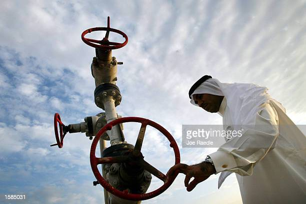 Khalid Abdulla Alhajeri looks at a natural gas pipe November 3 2002 in Manama Bahrain The country was the first in the Arab side of the Gulf to...