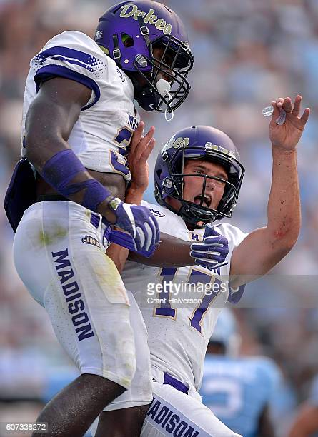 Khalid Abdullah celebrates with quarterback Bryan Schor of the James Madison Dukes after scoring a touchdown against the North Carolina Tar Heels...