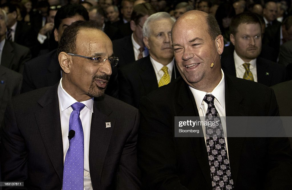 "Khalid Al-Falih, chief executive officer of Saudi Arabian Oil Co. (Saudi Aramco), left, and Ryan Lance, chairman and chief executive officer of ConocoPhillips, speak in the audience during the 2013 IHS CERAWeek conference in Houston, Texas, U.S., on Tuesday, March 5, 2013. The growth in new oil production has overturned ""doomsday scenarios"" about the decline of the petroleum industry, said Al-Falih during the keynote speech. Photographer: F. Carter Smith/Bloomberg via Getty Images"