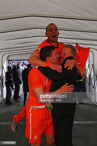 Khalid Boulahrouz and Wesley Sneijder of the Netherlands celebrate after the 2010 FIFA World Cup South Africa Semi Final match between Uruguay and...