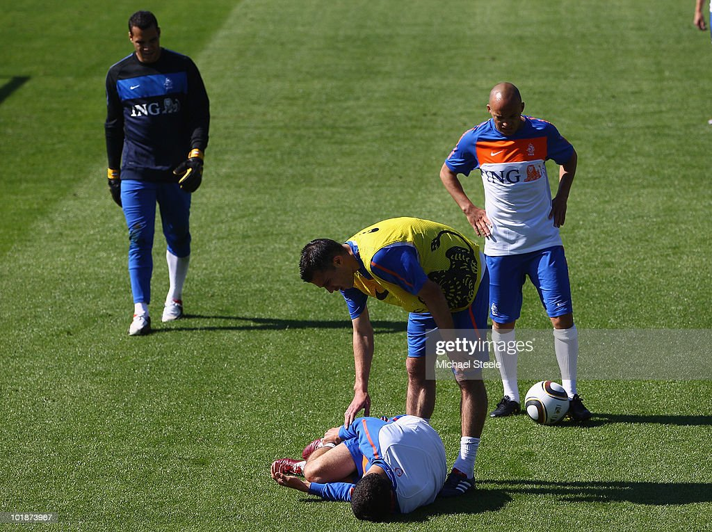 Khalid Boulahrouz lays injured as Robin van Persie looks on in concern during a training session at the Wits Rugby Stadium on June 8, 2010 in Johannesburg, South Africa.