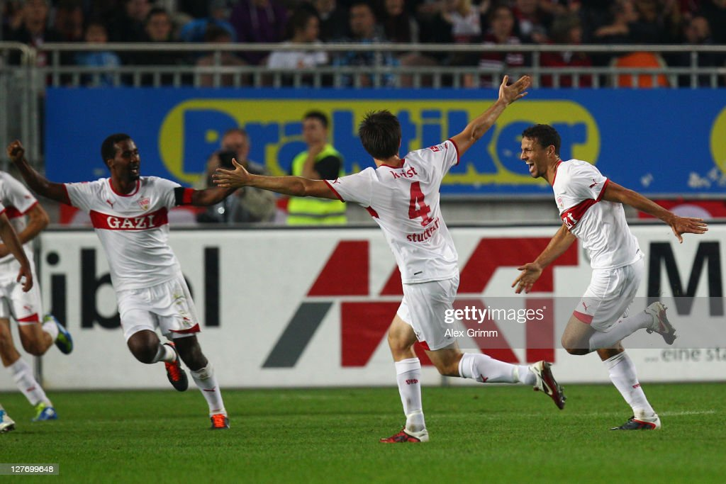 <a gi-track='captionPersonalityLinkClicked' href=/galleries/search?phrase=Khalid+Boulahrouz&family=editorial&specificpeople=538143 ng-click='$event.stopPropagation()'>Khalid Boulahrouz</a> of Stuttgart scores his team's second goal with team mates <a gi-track='captionPersonalityLinkClicked' href=/galleries/search?phrase=William+Kvist&family=editorial&specificpeople=2465270 ng-click='$event.stopPropagation()'>William Kvist</a> and <a gi-track='captionPersonalityLinkClicked' href=/galleries/search?phrase=Cacau&family=editorial&specificpeople=178248 ng-click='$event.stopPropagation()'>Cacau</a> (R-L) during the Bundesliga match between between 1. FC Kaiserslautern and VfB Stuttgart at Fritz-Walter Stadium on September 30, 2011 in Kaiserslautern, Germany.