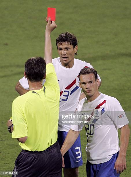 Khalid Boulahrouz of the Netherlands is shown the red card by Referee Valentin Ivanov of Russia after appearing to elbow Luis Figo of Portugal in the...