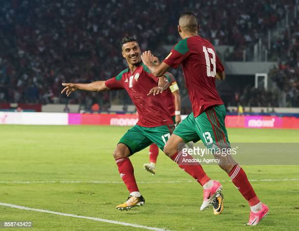Khalid Boutaib and Nabil Dirar celebrate after a goal during their FIFA World Cup 2018 Group C football match between Morocco and Gabon at Mohammed V...