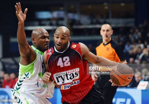Khalid ElAmin #42 of Lietuvos Rytas competes with Roderick Blakney #12 of Unicaja in action during the 20102011 Turkish Airlines Euroleague Top 16...