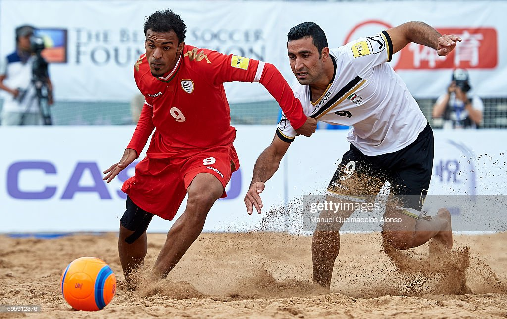 Khalid Khamis (L) of Oman competes for the ball with Mohammadali Mokhtari of Iran during the Continental Beach Soccer Tournament match between Iran and Oman at Municipal Sports Center on August 25, 2016 in Ordos of Inner Mongolia Autonomous Region, China.