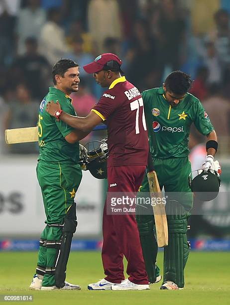 Khalid Latif and Babar Azam chat with Samuel Badree of West Indies chat after the first T20 International match between Pakistan and West Indies at...