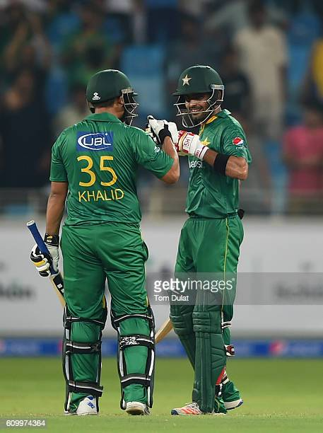 Khalid Latif and Babar Azam of Pakistan celebrate after the first T20 International match between Pakistan and West Indies at Dubai International...