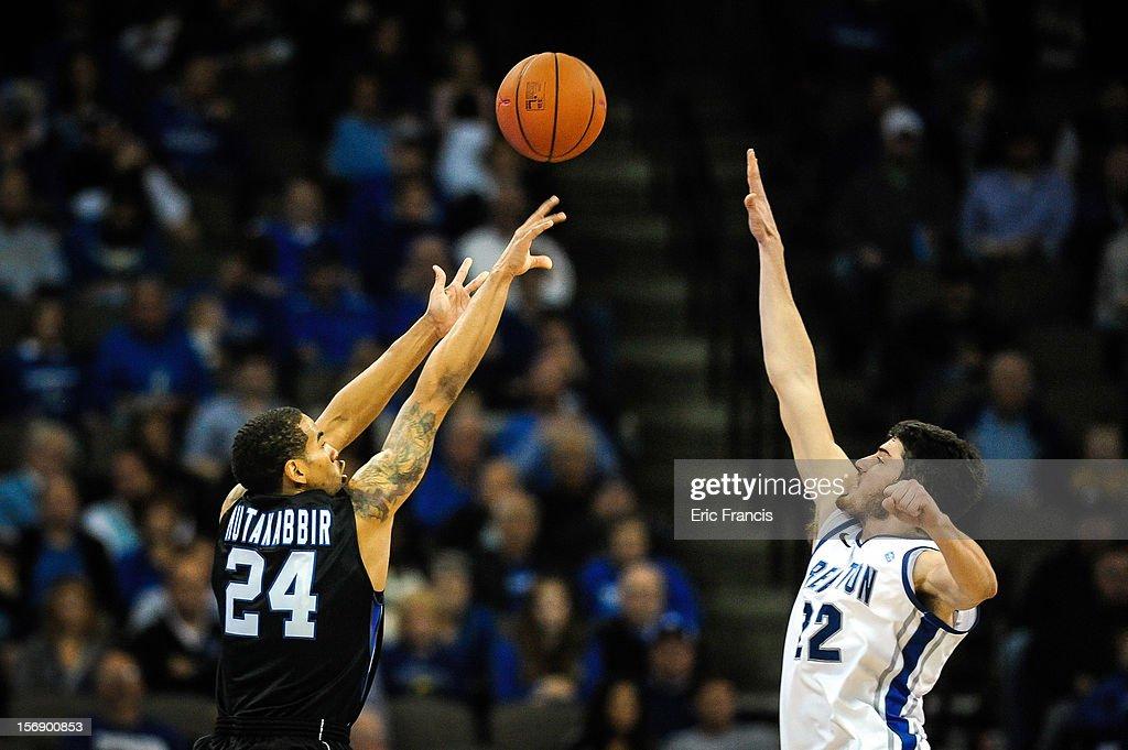 Khalid Mutakabbir #24 of the Presbyterian Blue Hose shoots over Avery Dingman #22 of the Creighton Bluejays during their game at CenturyLink Center on November 18, 2012 in Omaha, Nebraska.