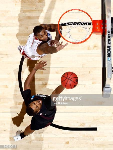 Khalif Wyatt of the Temple Owls drives to the basket against Richard Howell of the North Carolina State Wolfpack during the second round of the 2013...