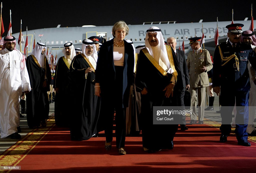 Khalifa bin Salman Al Khalifa, the Prime Minister of Bahrain, accompanies British Prime Minister Theresa May as she arrives at Sakhir Airbase on December 5, 2016 in Manama, Bahrain. Prime Minister May is to attend the annual Gulf Cooperation Council summit where she will meet regional leaders.
