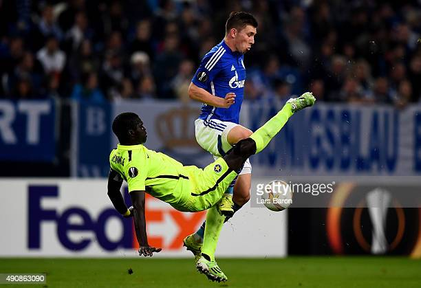 Khalifa Sankare of Asteras challenges Pierre Hojberg of Schalke during the UEFA Europa League Group K match between FC Schalke 04 and Asteras...