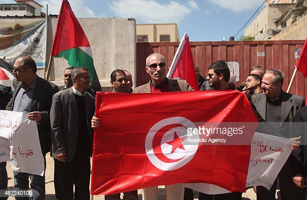 Khalil Abu Shemale head of the Al Dameer Association for Human Rights in Gaza city holds a Tunisian flag when Palestinian NonGovernmental...
