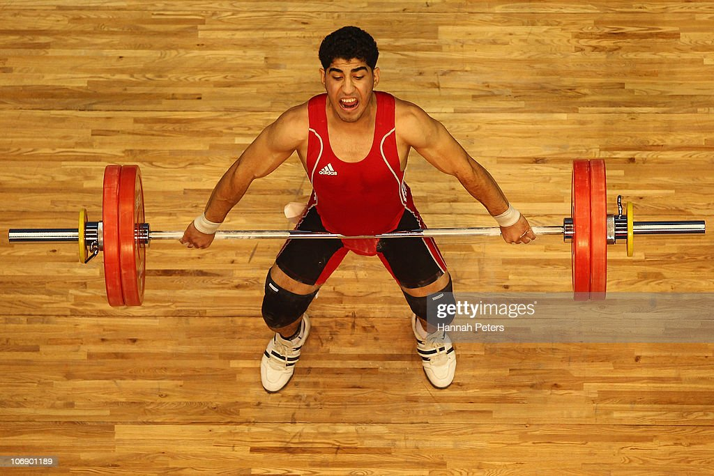 Khalil Alhamqan of Saudi Arabia competes in the Men's Weightlifting 77kg competition during day four of the 16th Asian Games Guangzhou 2010 at Dongguan Gymnasium on November 16, 2010 in Guangzhou, China.