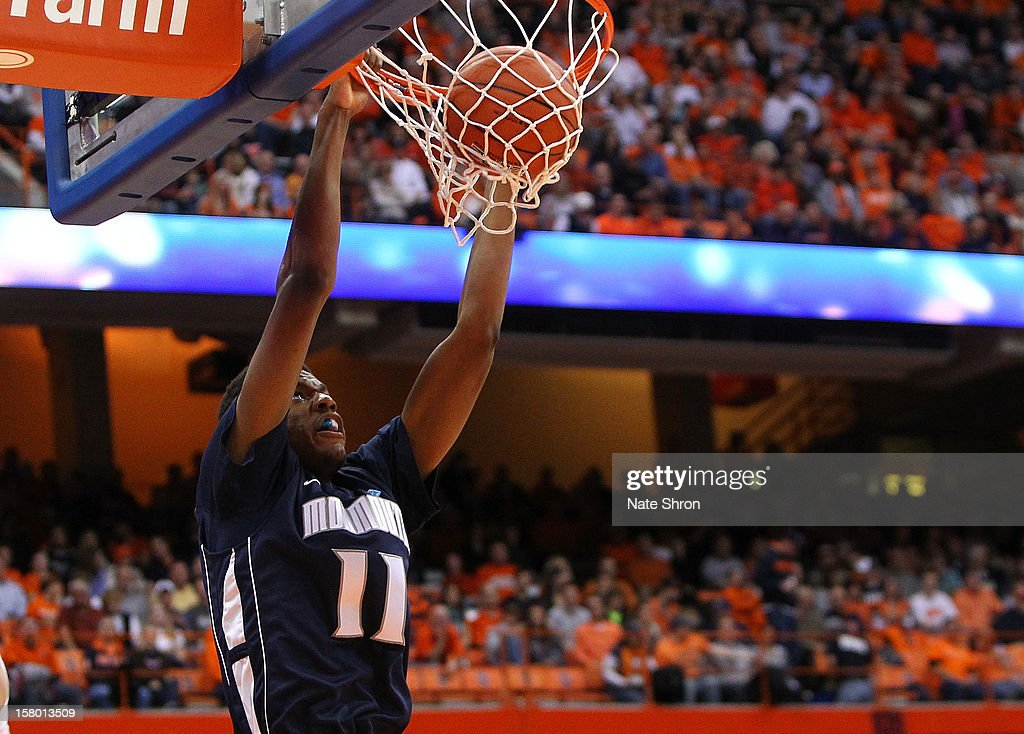 Khalil Brown #11 of the Monmouth Hawks dunks the ball during the game against the Syracuse Orange at the Carrier Dome on December 8, 2012 in Syracuse, New York.