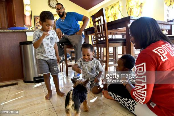 Khalil Carney offers a treat to Diggy as from left Malik RW Mekhi and Brianna watch May 26 2017 in Dumfries VA Keisha Carney had Essure implanted by...