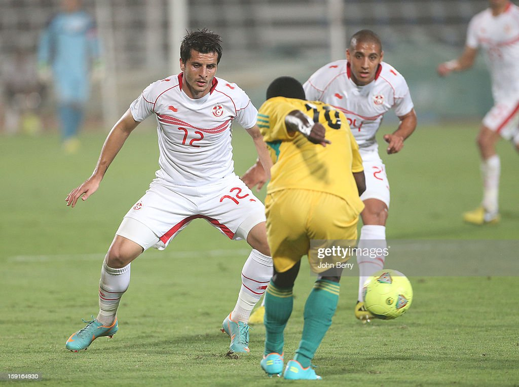Khalil Chammam and Wahbi Khazri of Tunisia in action during the international friendly game between Tunisia and Ethiopia at the Al Wakrah Stadium on January 7, 2013 in Doha, Qatar.
