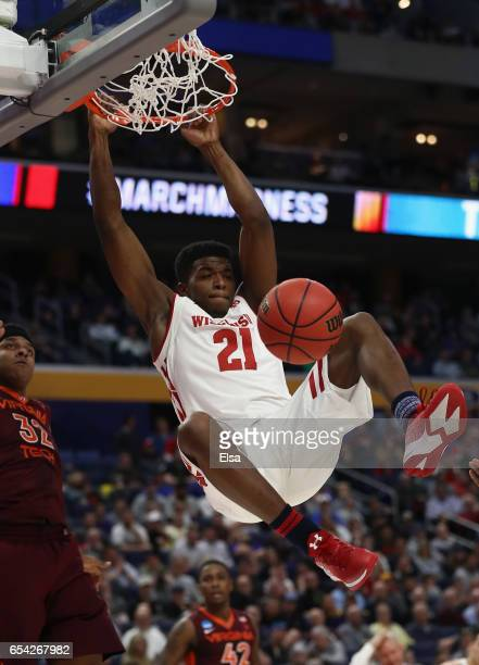 Khalil Iverson of the Wisconsin Badgers dunks against Zach LeDay of the Virginia Tech Hokies in the first half during the first round of the 2017...
