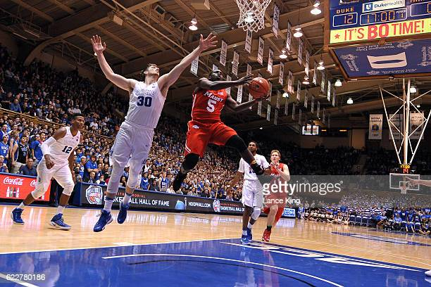 Khallid Hart of the Marist Red Foxes goes to the basket against Antonio Vrankovic of the Duke Blue Devils at Cameron Indoor Stadium on November 11...