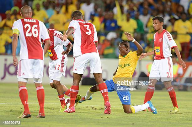 Khama Billiat is tackle by Sundowns players during the Absa Premiership match between Mamelodi Sundowns and Ajax Cape Town at Loftus Stadium on...