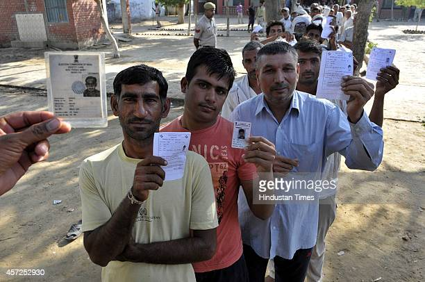 Kharak Bhura villagers in queue to cast their votes at one of the polling booth number 144 at Govt Sr Sec School for Girls Uchana Kalan Mandi area in...