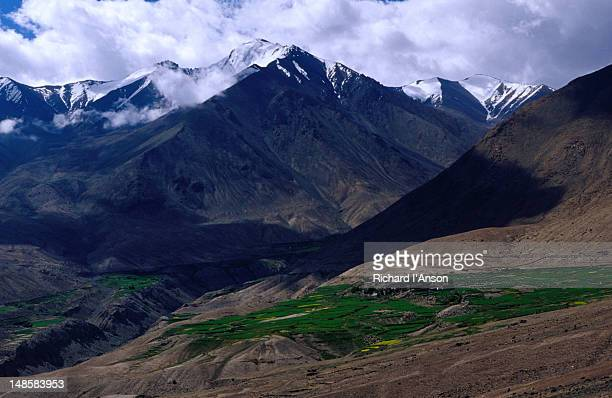 Khardung village and snow-capped peaks of the Ladakh Range in Nubra Valley.