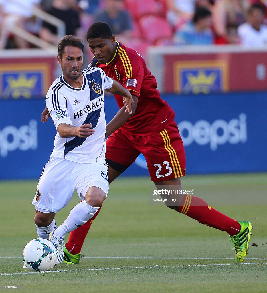 Khari Stephenson of Real Salt Lake and Marcelo Sarvas of the Los Angeles Galaxy fight for the ball during the first half of an MLS soccer game June 8...