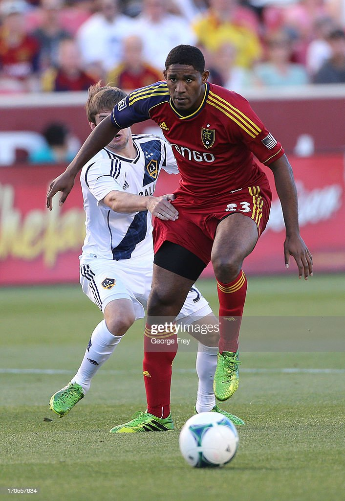 Khari Stephenson of Real Salt Lake is held by Greg Cochrane of the Los Angeles Galaxy during the first half of an MLS soccer game June 8 2013 at Rio...