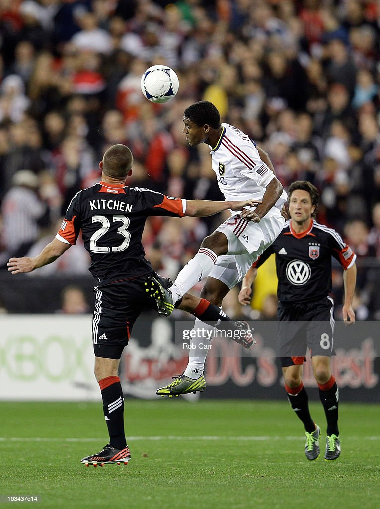 Khari Stephenson #23 of the Real Salt Lake heads the ball in front of Perry Kitchen #23 of D.C. United during the second half at RFK Stadium on March 9, 2013 in Washington, DC.