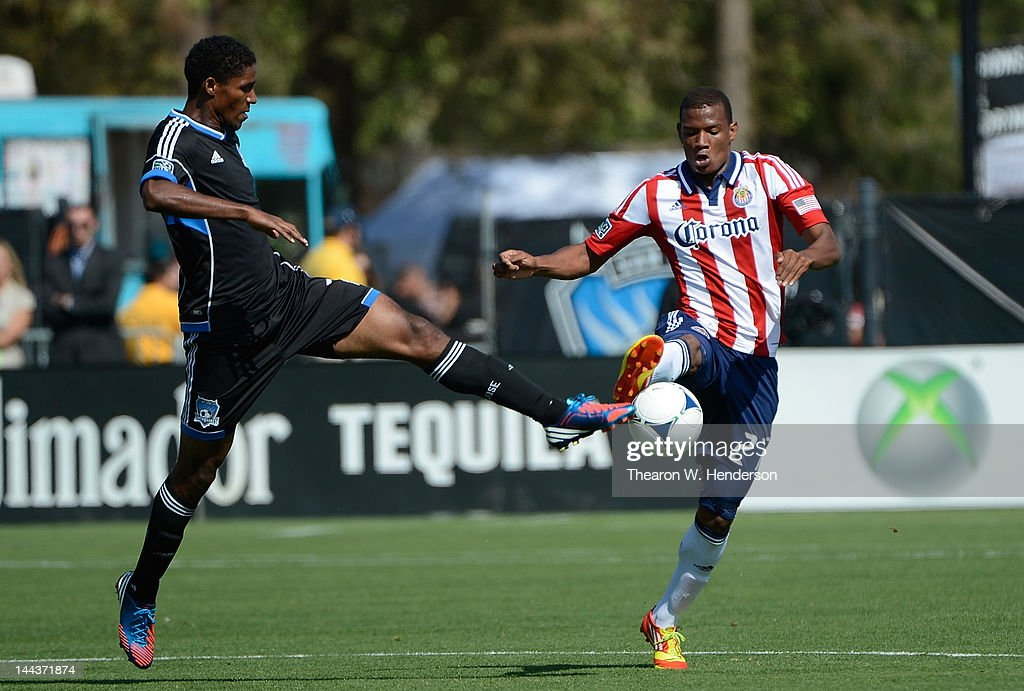 Khari Stephenson of the San Jose Earthquakes battle for the ball with Jose Correa of the Chivas USA in the first half of their game at Buck Shaw...