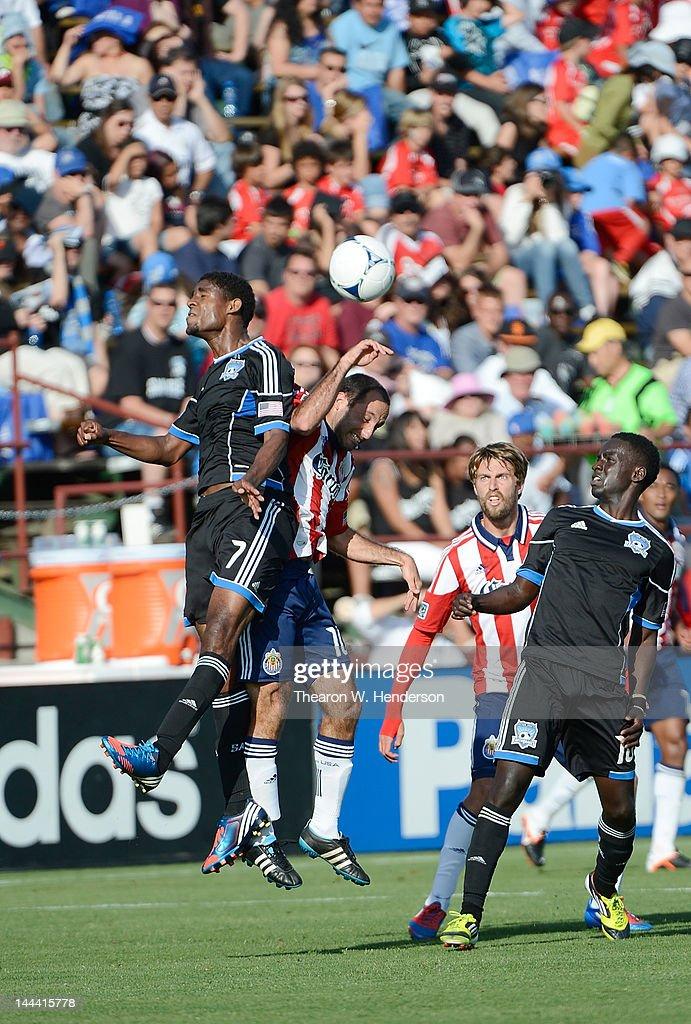Khari Stephenson of the San Jose Earthquakes hits a header over Nick LaBrocca of Chivas USA at Buck Shaw Stadium on May 13 2012 in Santa Clara...