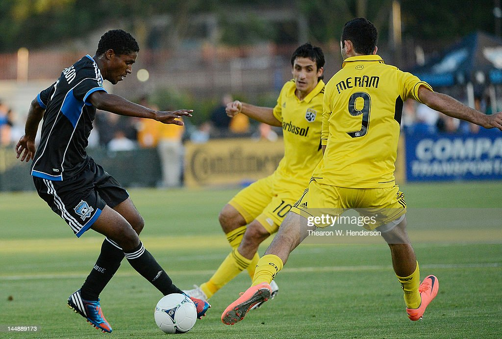 Khari Stephenson of the San Jose Earthquakes looks to dribble the ball pass Justin Meram of the Columbus Crew at Buck Shaw Stadium on May 19 2012 in...