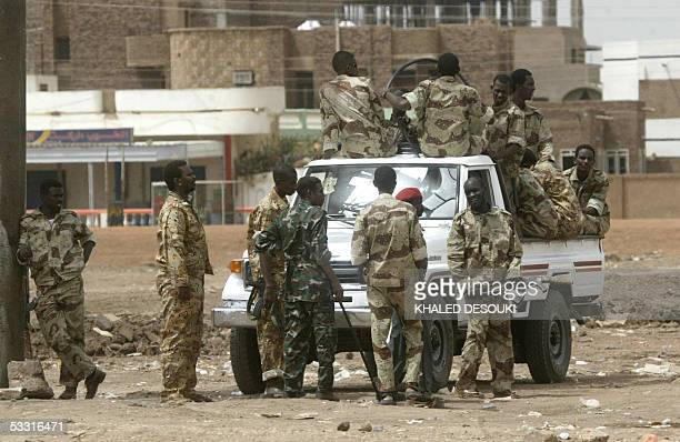 Sudanese soldiers on foot and in a pickup are on patrol in the street of Khartoum 02 Aug 2005 after riots continued Tuesday to rock the Khartoum...