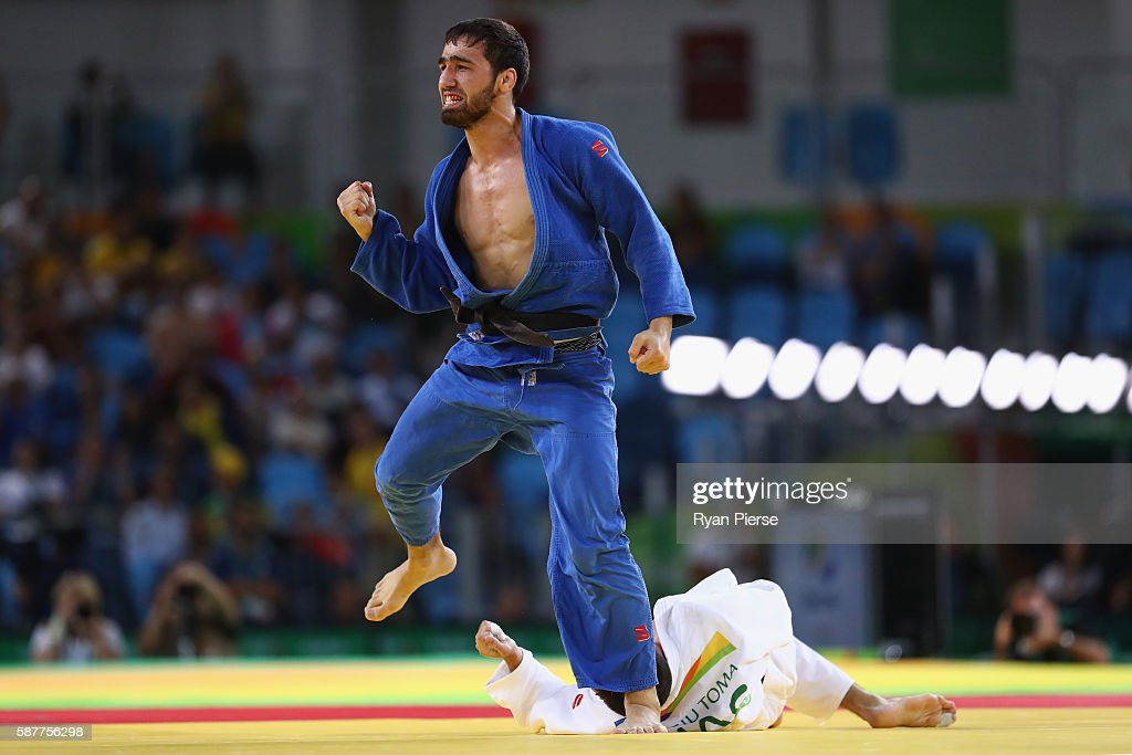 Khasan Khalmurzaev of Russia celebrates victory over Sergiu Toma of United Arab Emirates during the Men's 81kg semifinal bout on Day 4 of the Rio...