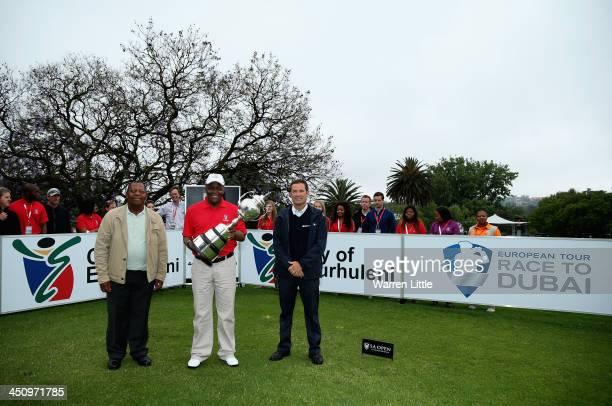 Khaya Ngqula Mondli Gungubele Ekurhuleni Mayor and David Williams Tournament Director of the European Tour pose with the trophy on the the first tee...
