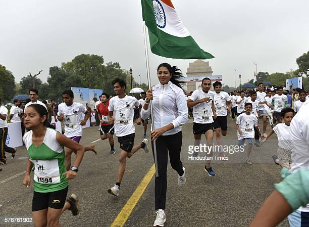 Khel Ratna awardee Anju Bobby George participates in The Great India Run India's first multicity marathon at India Gate on July 17 2016 in New Delhi...