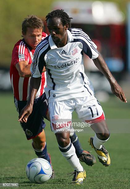 Kheli Dube of the New England Revolution dribbles the ball on the attack as Jesse Marsch of CD Chivas USA gives chase in the first half during their...