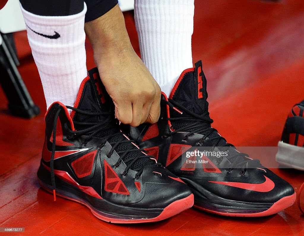 Khem Birch #2 of the UNLV Rebels changes his Nike sneakers before a game against the California State Fullerton Titans at the Thomas & Mack Center on December 28, 2013 in Las Vegas, Nevada. UNLV won 83-64.