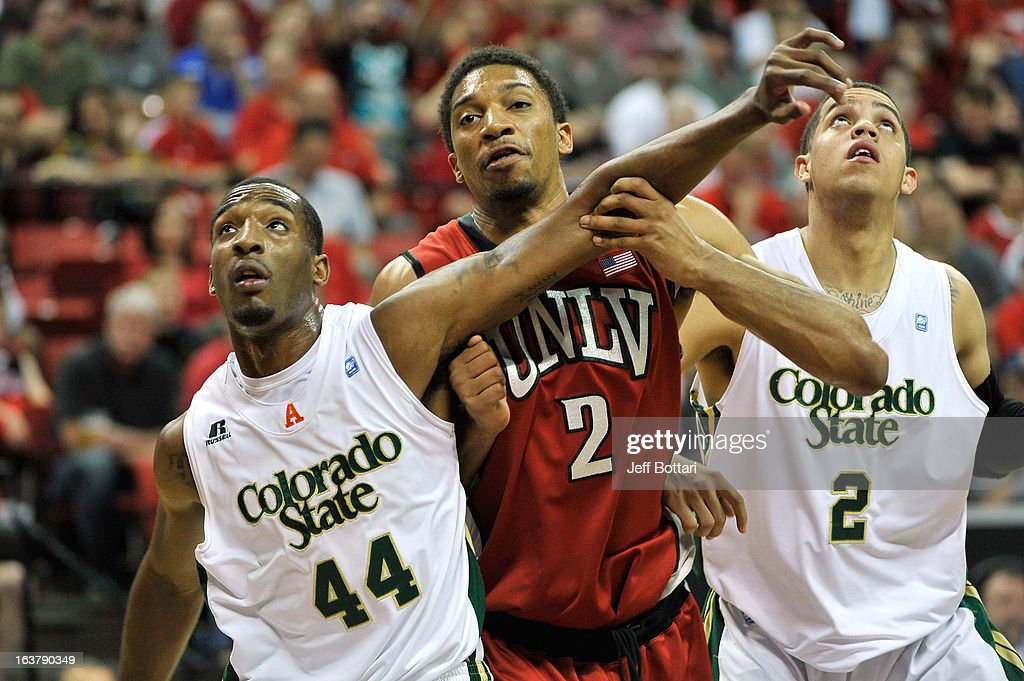 Khem Birch #2 of the UNLV Rebels fights for a rebound against Greg Smith #44 and Daniel Bejarano #2 of the Colorado State Rams during the second half of a semifinal game of the Reese's Mountain West Conference Basketball tournament at the Thomas & Mack Center on March 15, 2013 in Las Vegas, Nevada. UNLV won 75-65.