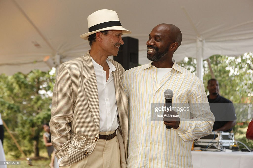 Khephra Burns and Ronald K. Brown, Artistic Director, Evidence, A Dance Company attend Evidence, A Dance Company Hosts 10th Annual 'On Our Toes'... In The Hamptons Summer Benefit at The Hayground School on August 17, 2013 in Bridgehampton, New York.