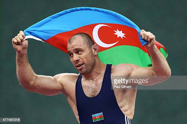 Khetag Gazyumov of Azerbaijan celebrates winning gold after defeating Elizbar Odikadze of Georgia during the Men's Freestyle Wrestling 97kg on day...