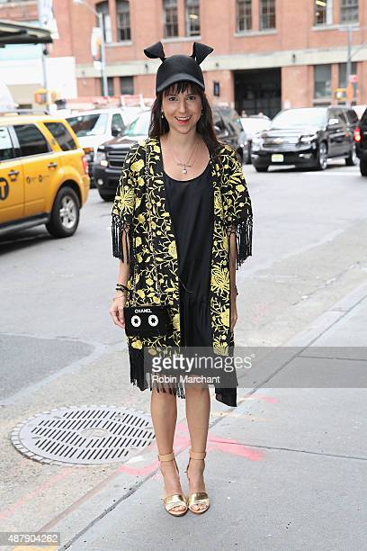 Khia Mevcev of wwwcurbingthecatwalkcom is wearing jacket by Alice and Olivia shoes by Loeffler Randall and hat by BCBGMaxazria as seen outside NYFW...