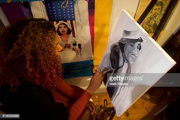 Khia Smith paints a portrait of Marian Anderson as Treasury Secretary Jacob Lew visits the residence museum of the opera singer and civil rights...